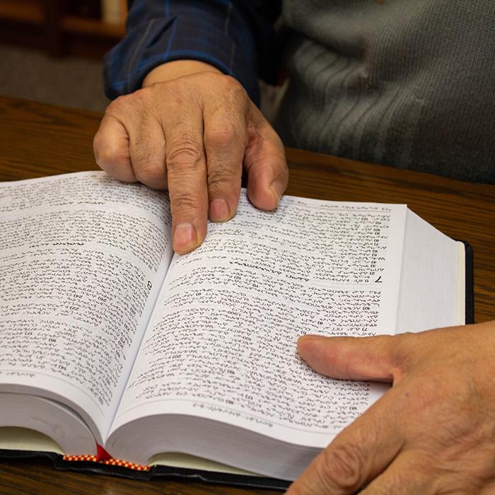 Hand on an open Bible