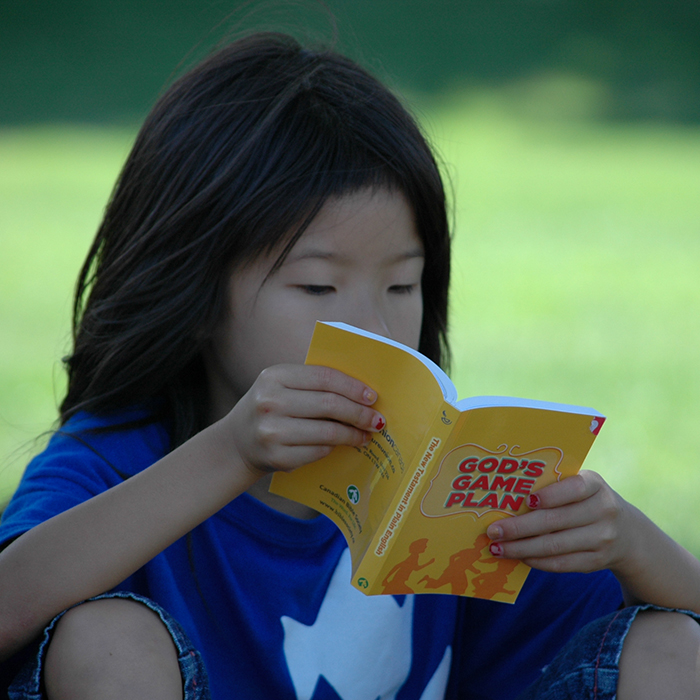 Child reading a Bible