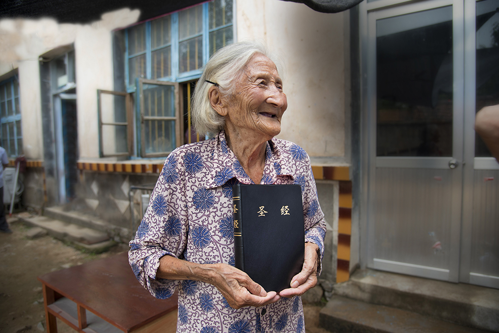 Elderly woman with Bible